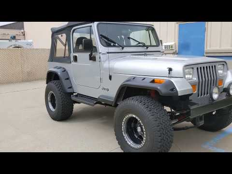 1995 Silver /Black Jeep Wrangler SE (1J4FY29S1SP) with an 4.0L L6 OHV 12V engine, 5-Speed Manual transmission, located at 603 Amelia Street, Plymouth, MI, 48170, (734) 459-5520, 42.378841, -83.464546 - Photo #0