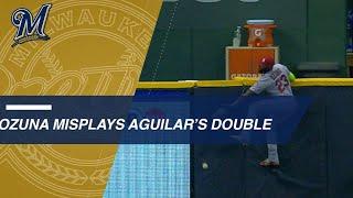 2 Brewers score on Ozuna's misplay at LF wall
