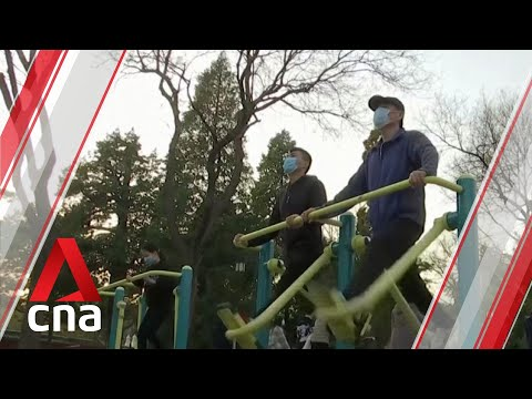 Locals return to parks in Beijing as China sees steady decline in COVID-19 cases