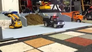 Loading Tonka dump truck with CAT track loader