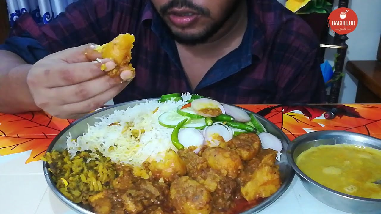 Eating Basmati rice with potato chicken curry