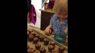 Mira decorating cupcakes