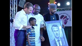 incredibly talented 11 year old kareem paints french president emmanuel macron