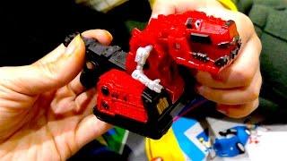 Большой игрушечный автовоз - транспортировщик машин и Динотракс