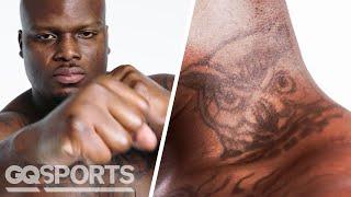 UFC Fighter Derrick Lewis Breaks Down His Tattoos | GQ Sports