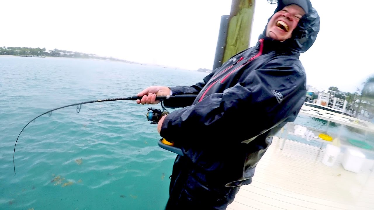 Fishing in brutal rain on the docks catch n cook doovi for Rain suits for fishing