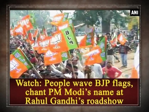 Watch: People wave BJP flags, chant PM Modi's name at Rahul Gandhi's roadshow - ANI #News
