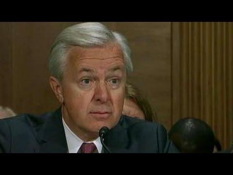 Bank watchdogs snap at Wells Fargo CEO