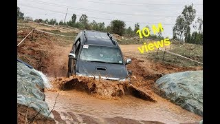 Toyota fortuner crawling through mud