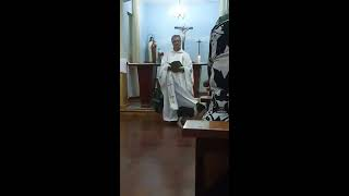 Curious Dog Plays With Priest's Robe While he Gives Speech in Church - 1098363