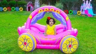 Sami and Amira Pretend Play with Princess Carriage Inflatable Toy