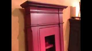 Wall mounted cabinet in red with black glaze......