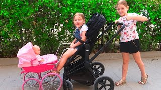 We are in the Stroller Wheels On The Bus Song Nursery Rhymes & Kids Songs