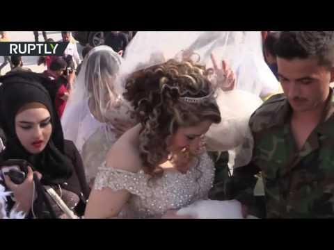 عرس جماعي يزف 30 جنديا سوريا في حلب