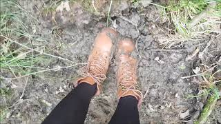 Brown heel boots in mud