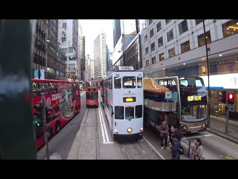 Hong Kong, double decker tram ride along Des Voeux Rd Central to Western Market