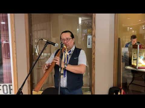 William Greenland plays flute in the Centre Square Mall Upper Level