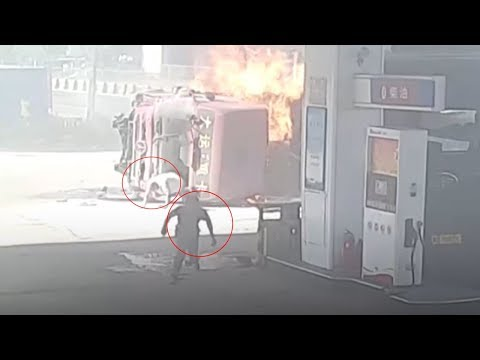 Truck bursts into flames after crashing at a gas station