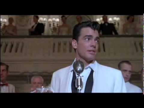 Peter Gallagher singing in The Hudsucker Proxy 1994