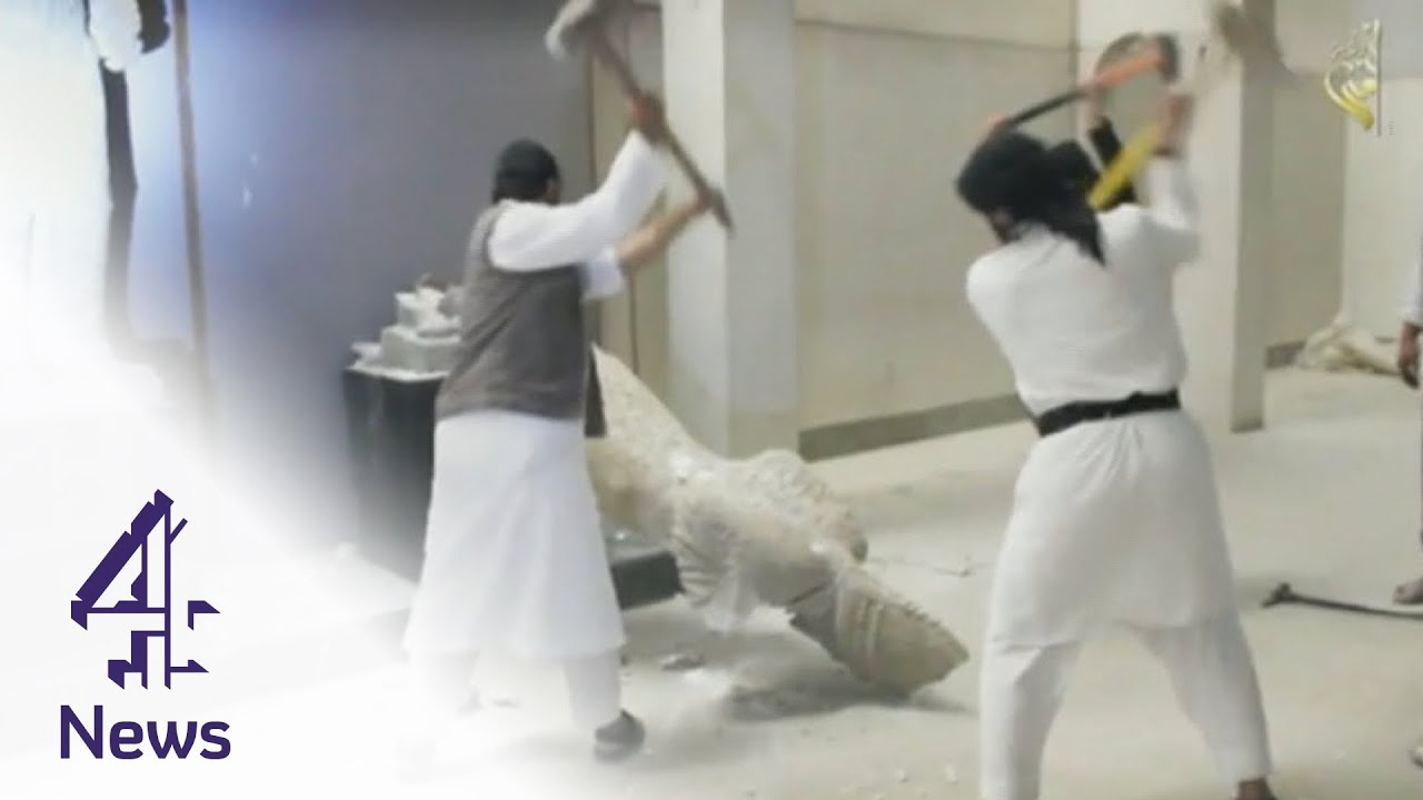 Download Islamic State fighters smash historic statues in Mosul   Channel 4 News