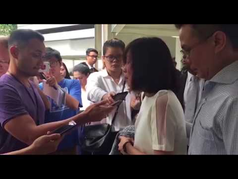 Tay Puay Leng and Chow Chuin Yee leaving the State Courts