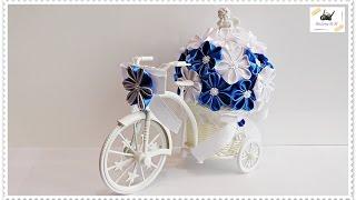 rowerek plastikowy trójkołowy  z kwiatami DIY