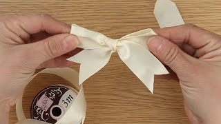 Katy shows us how to tie the perfect ribbon bow and finish it with ...