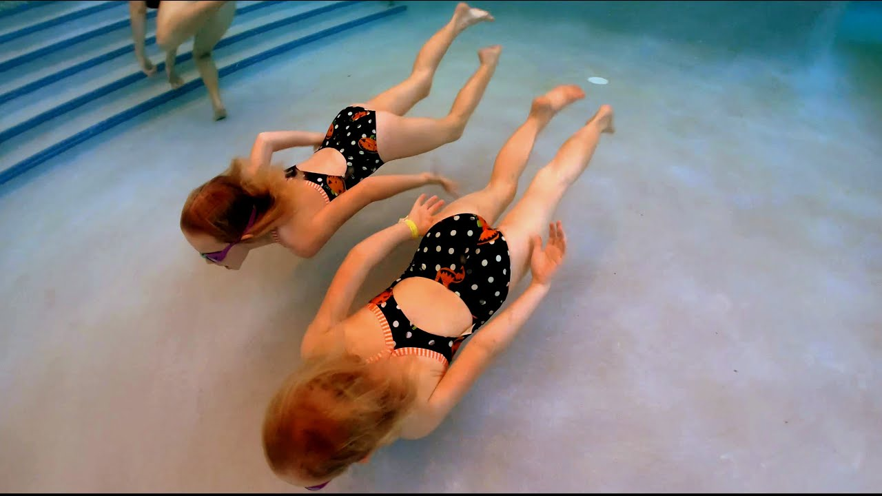 Twins Swimming in Matching Swimsuits