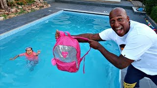 TIANA'S SCHOOL BACKPACK IN OUR SWIMMING POOL PRANK!!