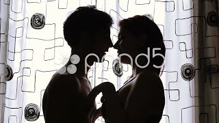 Silhouette Sex - Couple hugging in front of window - kiss - lover. Stock Footage