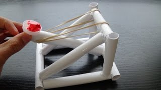 A homemade catapult made out of paper and some other household items, a great DIY project or science fair project. check out and
