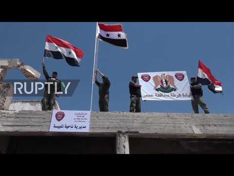 Syria: Cheers as Syrian flag raised in Homs