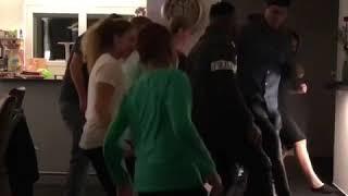 Swiss fans learning Ejeme Uwa Ole dance steps