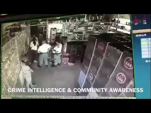 Police run away during a shooting incident in South Africa