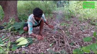 Natural way Corn cooking on the Flame by young farmer Ramanujam