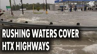 Raging water covering Eastex Fwy, Grand Pkwy