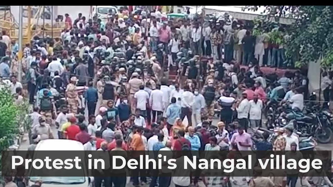 Nine-year-old Dalit girl's family members and residents of Delhi's Nangal village protest