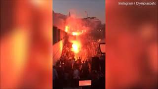 Yaya Toure welcomed by excited flare-wielding Olympiacos fans