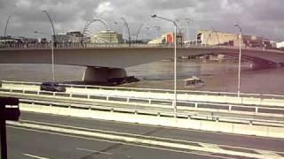 boat crashes into bridge in Brisbane flood