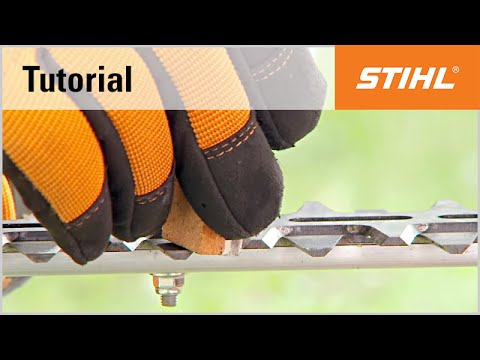 Sharpening the blades of a STIHL petrol hedge trimmer