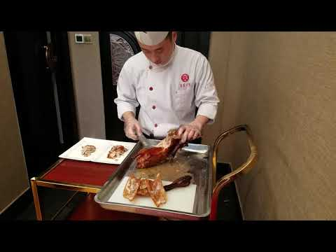 Traditional Peking duck carved tableside