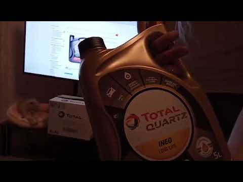 новая канистра масла Total