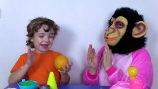 Makar and Monkey plays with Kinetic sand