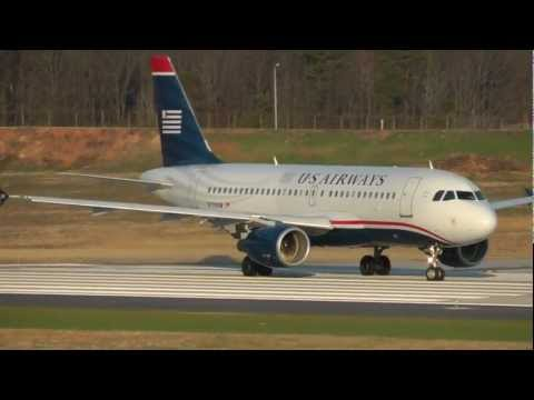 2 US Airways Airbus A319-112 jets taking off from Charlotte Douglas Intl N770UW and N775US