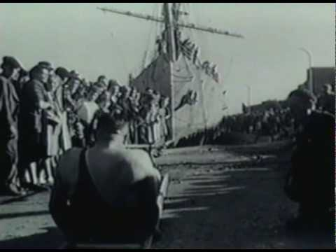 1930's strong man pulls plane and ship with his teeth.avi