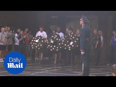 England fans and FA officials lay wreaths in Volgograd