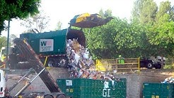 Waste Management Recycling Trucks Unloading