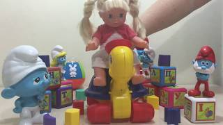 Baby girl - We collected the figures with the Smurfs - baby toys