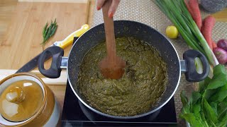 Zoom out shot of woman hands cooking delicious Sarson ka saag in a nonstick pan - Traditional Indian Food