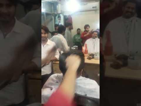 A hairdresser ignites client hair